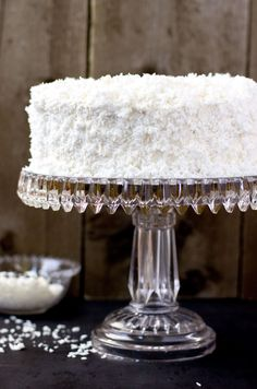 An old fashioned coconut cake, made with a soft, 2-layer vanilla cake, iced with an old-fashioned frosting covered in sweet coconut shavings.