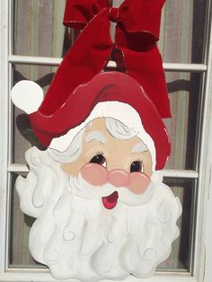 Hand painted wood Santa face with bow door hanger. 2ft tall by 14 in wide