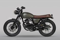 Mutt Motorcycles launches three new bikes for 2018 and they are as aggressively styled as ever - in the characteristic Mutt Motorcycle way. The new Mutt bikes are the MUTT MUTT HILTS GREEN 125 and MUTT SABBATH Suzuki Cafe Racer, Cafe Racer Bikes, Cafe Bike, Triumph Motorcycles, Custom Motorcycles, Chinese Motorcycles, Retro Motorcycle, Motorcycle Types, Women Motorcycle