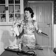 Gret Scott (1958), a 24 year old Judo instructor and at the time, Britain's only female exponent of Kendo. In this picture, Scott is seen cleaning her 300 year old samurai sword.