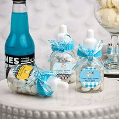 Charmed Baby Bottle Shower Favor...Bring sweet enthusiasm to baby showers and commemorate the exciting news of gender reveal parties with these Pink Baby Bottle Shower Favors! These darling containers provide excellent ways to make your celebrations even more special. Small clear, shiny, translucent, and durable plastic bottles are adorned with threaded-look plastic caps.