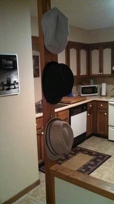 My boyfriend made hat hangers by bending old spoons and using double sided tape to hang them. Hat Hanger, Hangers, Stacked Washer Dryer, Washer And Dryer, Bending, Spoons, Clever, Tape, Boyfriend
