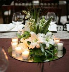 Centro de mesa con velas y espejo