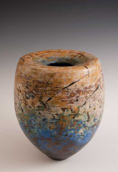 Sculptural ceramics, hand built organically-themed works that engage a sense of rhythm, flow, grace and balance – oceans in clay.