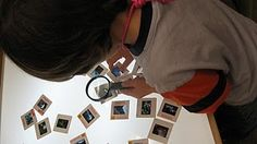 Art slides and magnifying glass on light table