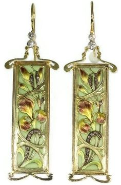 Plique-à-jour enamel Art Nouveau stained glass window earrings. Mounted in 18k gold and set with old mine- and rose-cut diamonds and senailles. The earrings were most likely panels of a dog-collar necklace. Circa 1900. #ArtNouveau #earrings