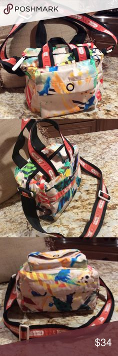 Awesome Le Sportsac Multi- Colored Bag This Le Sportsac Bag a Fabulous. Fun splashes of color make this Artist Residence print easy to wear. Adjustable, removable shoulder strap.  Two outside pockets , one zippered inside pocket. LeSportsac Bags Shoulder Bags