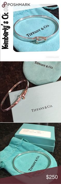 """✨TIFFANY & Co✨ Hook & Eye Bracelet % AUTHENTIC TIFFANY & Co Hook and Eye bangle bracelet.  Sterling silver with 18k gold accent.  Comes with original box with item ID label and jewelry pouch (see photo).  Measures 2.5"""" across from side to side.  Opens for easy on off (see photo).  Bracelet was not worn often.  Small scratch marks in silver (mostly on back side - see photo) just from the general way silver wears.  Matching ring also listed in my closet. Tiffany & Co. Jewelry Bracelets"""