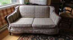 Loveseat with Carved Wood Trim