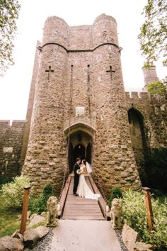 A beautiful couple's portrait in front of a castle | Shane Godfrey Photography | blog.theknot.com