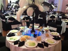 All white wedding decor for adelaide wedding reception www adelaide wedding reception decoration with black and white ostrich feathers and blue table lighting www junglespirit Image collections