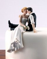 a little different... bride and groom sitting as a cake topper