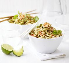 Whizz up a pesto with a difference by blending basil, coriander, peanuts, chilli and lime, then serve on egg noodles with flash-fried prawns