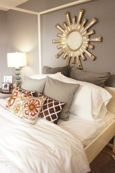 Bedroom Inspiration:  Cream headboard, rich gray walls; brown, cream and gray tones in bedding with crisp white duvet