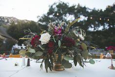 Temecula Creek Inn Moody burgundy & brass centerpiece by San Diego wedding florist, Compass Floral.