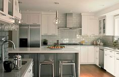 Gray island with white wall cabinets
