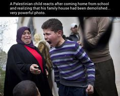A Palestinian child reacts moments after coming home from school and realizing that his family house had been demolished by the municipality in the east Jerusalem neighborhood of Beit Hanina