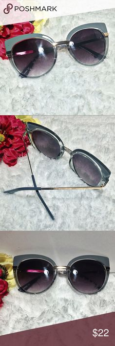 """""""Laurie"""" Fossil gray and clear Frame with black smoked Lens ⭐️⭐️TOP SELLER - Next Day Ship⭐️⭐️ Take a psychedelic blast to the past and enjoy these super cute and unique dual colored cat eye sunnies! Glossy top frame and clear lower frame with metal gold trimmings! Gorgeous colored lens really gives this a groovy look!   Frame Length 14 cm Frame Height 5.5 cm Nose Bridge width 2.5cm Uv 400 protected Accessories Sunglasses"""