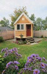 260 sq ft home allows its owners more freedom to live simply, to easily relocate (if necessary), and to use fewer resources. This tiny house includes a kitchen, living room, bathroom, sleeping loft, small storage loft and an extended porch. | Tiny Homes