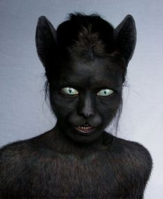 Scary cat makeup. Eyes drawn onto eye lids and teeth drawn onto lips. Uhhh...but the hair though...
