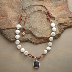 """SNOWDRIFT NECKLACE- -Snowy white pearls cozy up to fiery garnet in a handmade necklace that spans dressy and casual with considerable cool. Bead and loop closure. Leather. USA. Exclusive. 18""""L"""