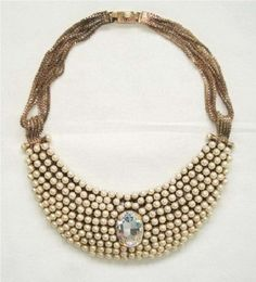 Carrie's necklace from SATC 2 designed by Rodrigo Otazu!    http://www.rodrigootazu.com/