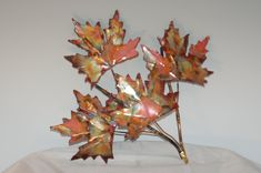 Copper Maple leaf branch: handcrafted metal sculpture,home decor, metal wall art. $29.95, via Etsy.