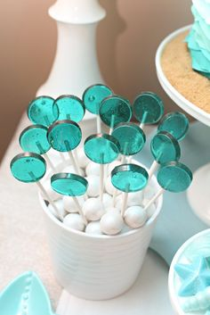 12 Aqua Lollipops - Blueberry Muffin flavor -  mermaid party edition - candy favors. $30.00, via Etsy.
