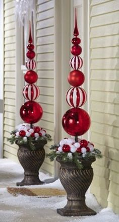 Outside decorations. No tutorial, but I guess you could gorilla glue a bunch of ornaments together in an urn.