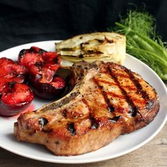 Thick Grilled Pork Chops | It is grilling season friends. I love grilling. It's easy and it doesn't heat up your house which equates to summer dinner awesomeness. You have got to try a grilled pork chop. They are magical. Here's the key: buy a thick pork chop. If you don't see one sitting out, go ask your butcher about it. You need a bone-in double thick pork chop for the grill and, oh my, it creates something amazing. Hunt down that chop and get to grilling! | From: thestayathomechef.com