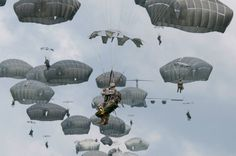 photo from the final phase of the Garuda Shield 2013 field training exercise. TNI-AD (Indonesian Army) and U.S. Army paratroopers make a partnered tactical jump into Baggy Pants Drop Zone on West Java and clear several buildings of insurgents.