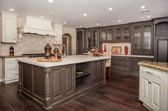 Kitchen. brown white wooden cabinet with storage having glass doors combined with kitchen island with shelves and white counter top. Gorgeous Two Toned Kitchen Cabinets Creating A Stunning Kitchen