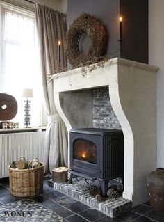 A hearth AND a cast iron stove. Oh my heart.