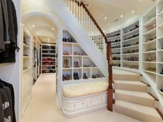 Not just a walk in closet, but a room dedicated for your wardrobe! Cool idea and love how there is so much shelves in every wall.