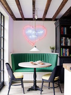 Small Round Dining Table Curved Green Banquette Seating booth, modern dining chairs and a Tracey Emin neon art on the wall. great breakfast or dining nook. Kitchen Banquette, Banquette Seating, Kitchen Nook, Eat In Kitchen, Kitchen Seating, Smart Kitchen, Compact Kitchen, Copper Kitchen, Kitchen Island