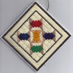 Spoolie plastic canvas needlepoint ornament. Find this project FREE at: http://www.nuts-about-needlepoint.com/spoolies-plastic-canvas-needlepoint-quilt-ornament-free-pattern/