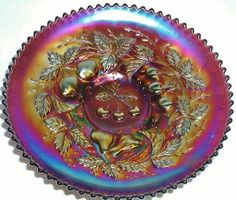 """http://www.longbrookantiques.comAntique/Vintage NORTHWOOD Carnival Glass Brilliant Purple 3 Fruit with Basket-weave reverse pattern Deep Plate. The Bold and Beautiful Iridescent finish on this item boarders on electric and will add much color to any collection. As is common for this pattern, there is some very light wear to the high points of the pattern, not much but it has a very little amount. Measures 8 3/4"""" X 1 3/4"""". This item is marked with NORTHWOOD's underlined capital N in a circle."""