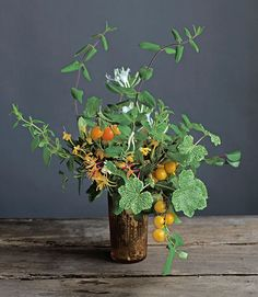 What You Need: A tall, narrow container 8 stems honeysuckle 3 branches wildplum 2 stems 'Crocodile' geranium leaves   - HouseBeautiful.com