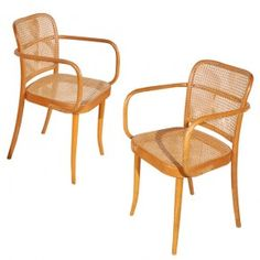 Josef Hoffmann Prague Chair Country of Origin: Checklosovakia Manufacturer: Stendig or Thonet Date: Mid 1930s - Mid 1960sPoland Materials: Beech bentwood with natural cane seats and back Length: 20.5 Depth: 20 Height: 34 Seat Height: 18 Note: