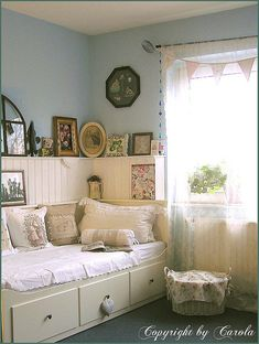 .Guest room/office. Not a fan of the shabby chic colors but love the daybed idea.