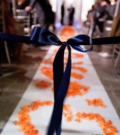 Great idea for wedding aisle - tie a ribbon to make your guests enter at either side. The flower girl/ring bearer then unties the ribbon to start the bridal procession.