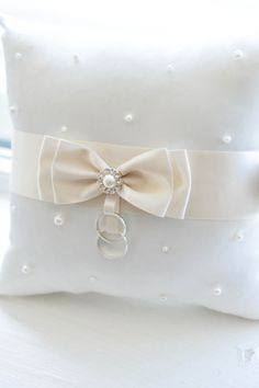 like the idea of a snap to hold rings instead of ribbon?    satin - bow - pearls - brooch