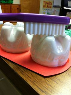 Teeth made from bottom of plastic soda bottles to teach a lesson on what sides of teeth need to be brushed and on how to floss using yarn for floss and tissue paper for food particles. Perfect for dental health lesson!