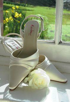 Bridal shoes. Daffodil backdrop. Photo by Tamsyn Hayward Photography