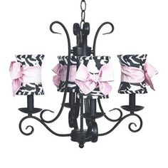 Price: $362.34 Jubilee 74507-2810-505 4 Light Harp Chandelier, Black - Simplistic affordability. Scrolled iron mirrors the shape of a harp on this 4-arm chandelier. Perfect for a bedroom or even a bathroom. It is dressed in zebra print hourglass chandelier shades with bows.
