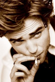 Robert Pattinson. There is no denying that he is extremely sexy. I have decided not to hold him playing a sparkly vampire against him. And instead, listen to his beautiful music and look at his beautiful face.