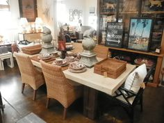 One step from the #beach is this #dining #table vignette at #LosAngeles #Mecox #interiordesign #mecoxgardens #furniture #shopping #home #decor #design #room #designidea #vintage #antiques #garden #woven #trays #linen