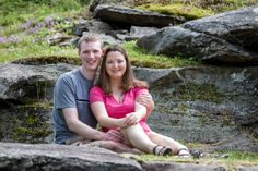 A couple sitting in a rocky area. Copyright Photographics Solution 2013