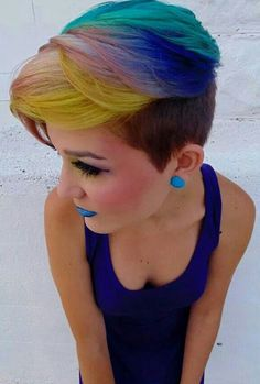 Rainbow dyed short hair. Who says you can't dye your hair creatively when it's short? This is a wonderful example of using the bangs to the fullest by dyeing it in various shades to stand out.