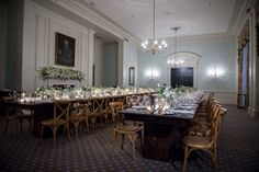 ann whittington events elegant rehearsal dinner southern style country club wedding rehearsal dinner two long tables antlers wood chairs